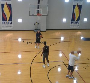 After practice Coach Brown takes time to improve shooting form of injured rookie Noel Nerlens
